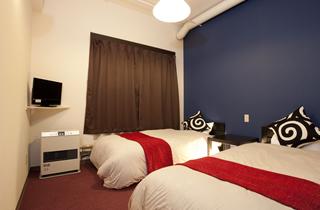 洋室ツインルーム赤系の写真